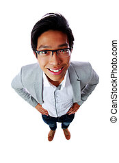 Top view portrait of a smiling asian man isolated on a white...