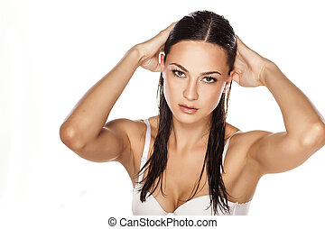 wet hair - beautiful young woman posing with wet hair