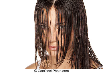 wet hair - beautiful young woman looking through her...