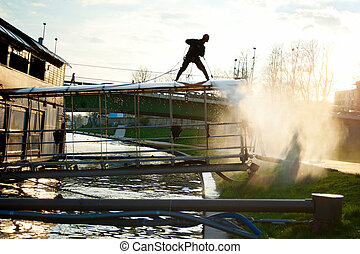 Proffesional Cleaning - Man cleaning floating restaurant in...