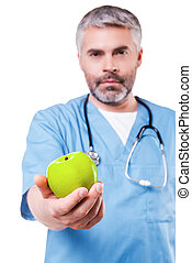 Join healthy lifestyle! Confident mature surgeon in blue...