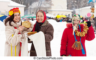 woman tasting pancake during Shrovetide - Smiling woman...