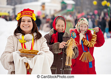 women celebrating Maslenitsa festival - happy women...