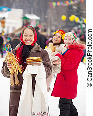 Mature woman during Shrovetide - Mature woman with pancake...