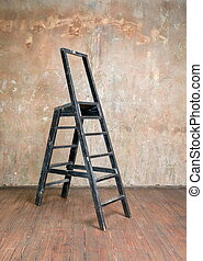 Stepladder in a room with hardwood floors around a shabby...