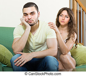 Woman concoling depressed man - Young wife tries reconcile...