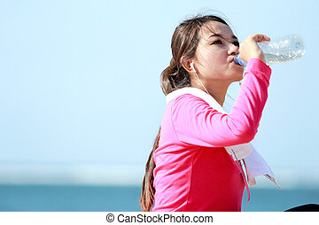 fitness woman drinking water - Portrait of asian healthy...