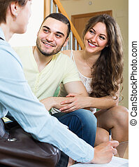 Loving couple with real estate agent