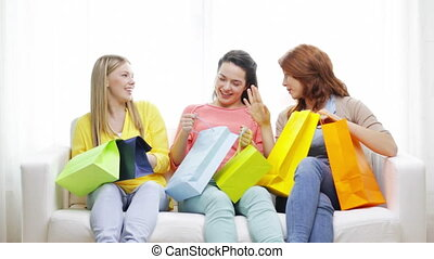smiling teenage girls with many shopping bags - shopping and...