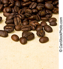 Coffee beans on old paper