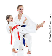 Girl teaches a sister beat kick leg - Two sisters, one...