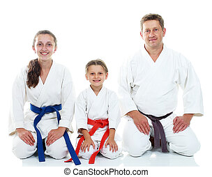 Dad with daughters in pose Karate - Dad with two daughters...