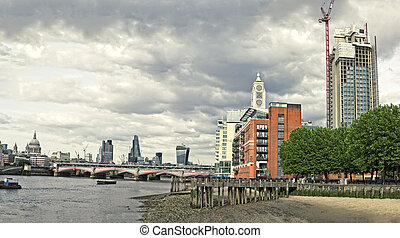 Skyline of City of London with Blackfriars Bridge over River...