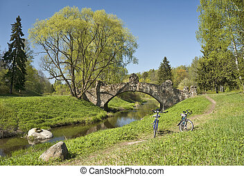 Old bridge and two bicycles