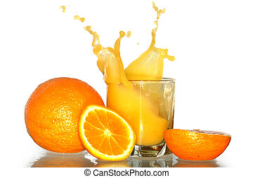 Splashing Orange Juice - Glass with splashing orange juice...