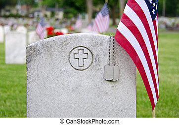military dog tags on tombstone - American flag and and...