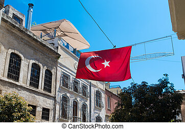 turkish flag hanging in the streets of Istanbul