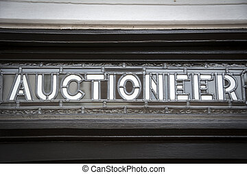 Auctioneer sign - Close up of glass and lead sign outside...