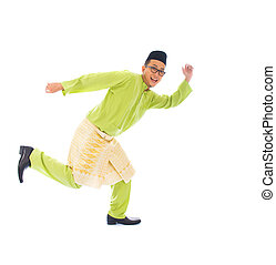 malay male jumping celebrating hari raya eid fitr after...