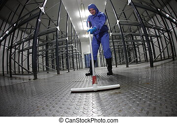 cleaning floor in empty storehouse