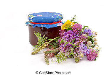Honey and flowers - A jar of honey and wildflowers