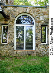 Leaded Glass Windows - Leaded glass windows in an old stone...