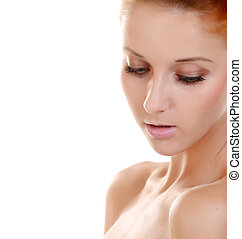 Beautiful woman with a natural make-up. Care of a skin. Spa