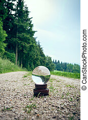 Crystal ball on a dirt road - A crystal ball on a dirt road...