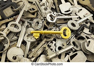 gold skeleton key and old metal keys - closeup gold skeleton...