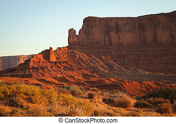 Monument Valley - Sunrise on a butte at Monument Valley,...