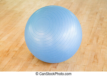 Swiss ball - Pilates ball on a wooden floor in a gym