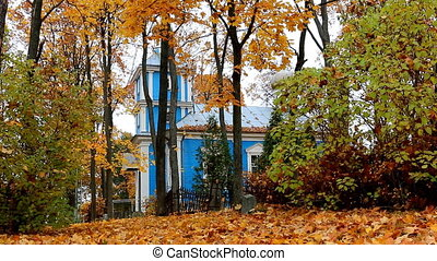 Autumn. Blue church - Blue wooden church and a few...