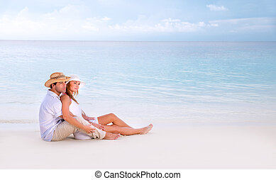 Honeymoon on Maldives - Young family spending summer...