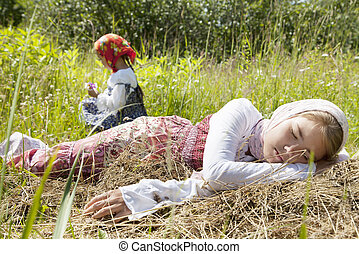 Village girls in a field - Little girl sleeping in a field...