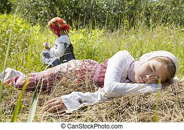 Village girls in a field - Little girl sleeping in a field...