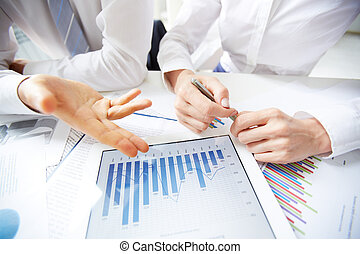 Business report - Close-up of female and male hands over...
