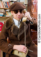 By the phone - A man in old-fashion clothing, talking by...