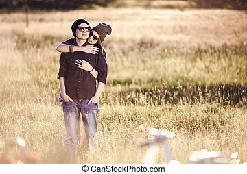 Young fashion hipster couple in love kissing and having passion in spring sunny weather