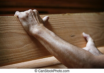 hands on wood - two male hands holding a piece of...