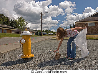 Girl Picking Up Litter