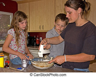 Mom and Kids Baking Cookies - This young mom is baking...