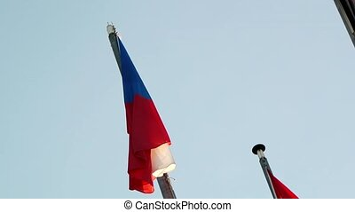 Flag of the Czech Republic waving as seen from below point...