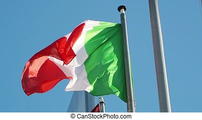 Flag of the Italian Republic waving as seen from below point...