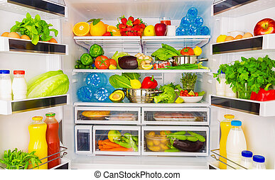 Healthy food concept - Open fridge full of fresh fruits and...