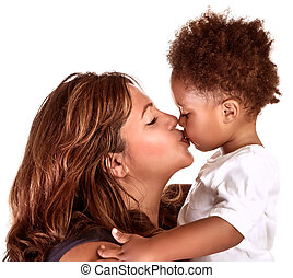 Cheerful mother kissing baby - Portrait of cheerful mother...