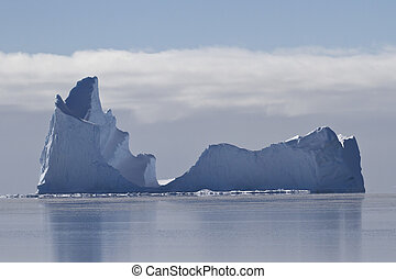 large iceberg with a single vertex in the waters of the Southern