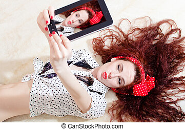 beautiful young attractive woman pinup girl lying and taking...
