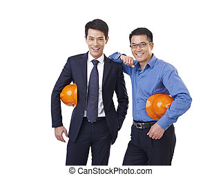asian men with orange safety hat - portrait of two asian men...