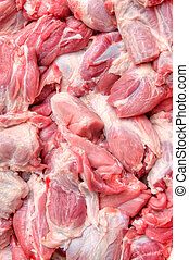 the fresh meat, close- up - Blocks of the fresh meat lay on...