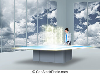 Innovative technologies - Young businessman looking at...